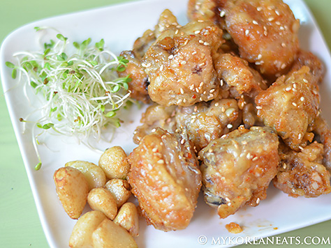 ... korean fried chicken with soy garlic sauce and sweet and hot sauce at